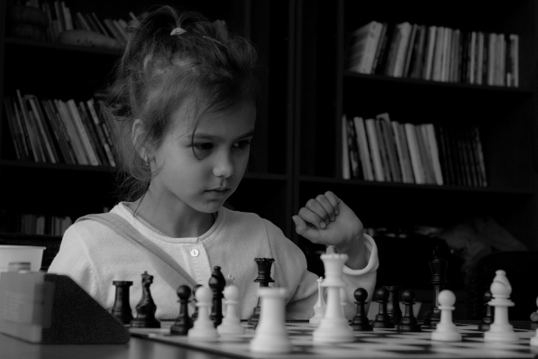 A little girl playing real chess in competition. Black and white photo. Concentrated kid. Power of concentration ** Note: Soft Focus at 100%, best at smaller sizes