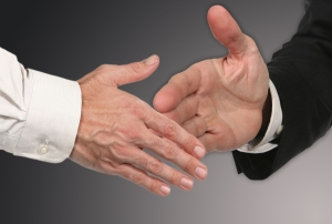 Men shaking Hands Closing a Deal