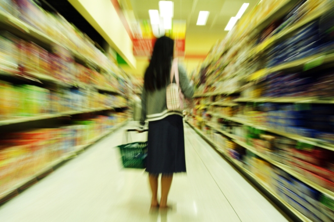 a woman shopping in a grocery store